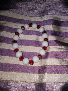 White and Red color Bracelet.