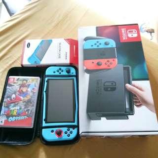 Nintendo Switch  w/ Super mario odessey Game