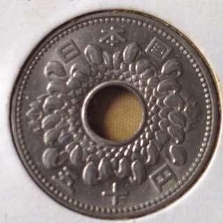 1966 Japan 50 cents coin.