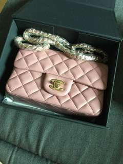 Vintage Chanel mini flap pink