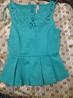 Teal peplum blouse with cutout neckline