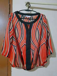 Red blouse with pattern design