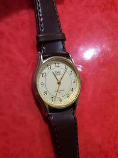 Q &  Q         her watch