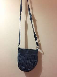 Leather sling bag from Italy