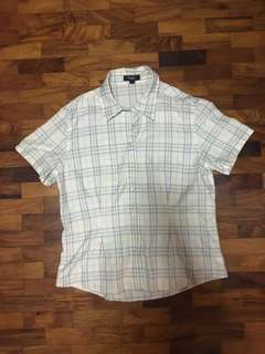 Authentic Burberry pastel plaid polo L on tag