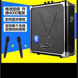 Karaoke loud speaker system with two mic and one ear pcs chargeable batteries Bluetooth
