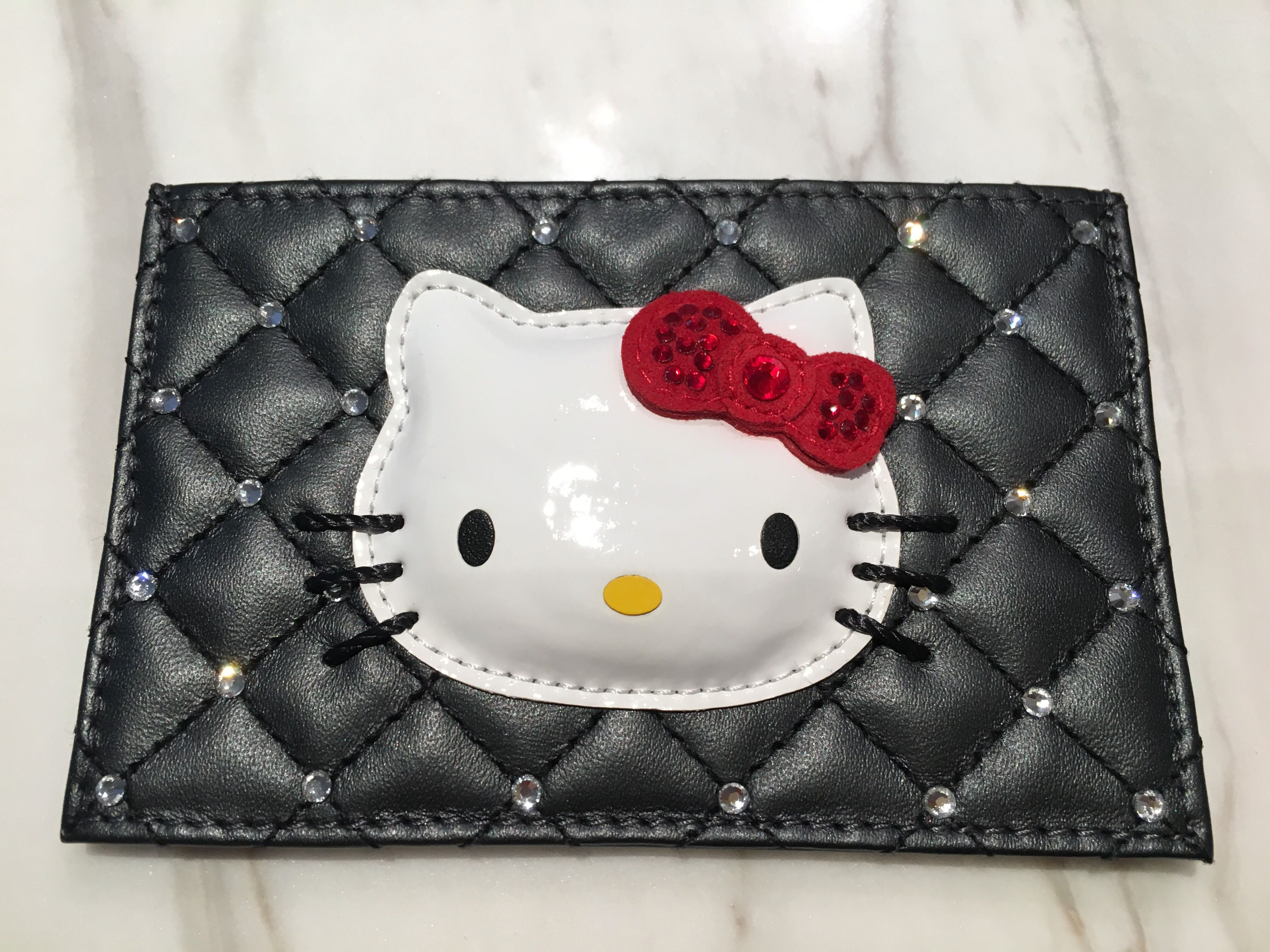 c571077d4 Brand new Swarovski Hello Kitty Card Holder, Women's Fashion, Bags &  Wallets, Wallets on Carousell
