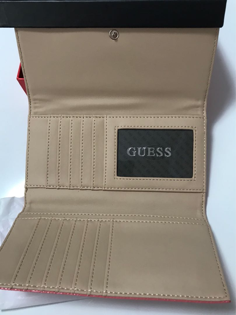 Spring cleaning sale - Original Guess wallet. Brand new comes complete in box. Sweet peachy pink colour, can take up to 14 cards with coin compartment as shown in photos.