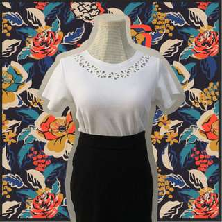 White blouse with lasercut details
