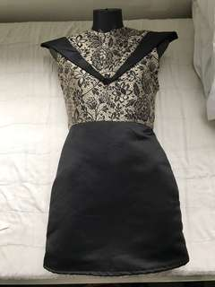 Designer women's dress size 8-10 gold and black with pointy shoulders