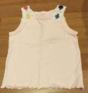 Grin Kids embroidered at shoulder area. A sleeveless top