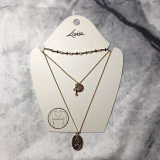 influencer style gold layered cross necklaces