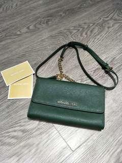 Michael Kors Jet Set Travel sling wallet on chain
