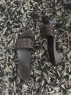 GUCCI WOVEN LEATHER SLIDES