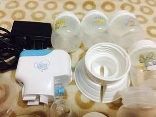 (repriced)electric breast pump with free (3)2oz baby bottles and (2) bottle holder