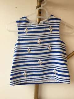 Sleeveless top with jewels