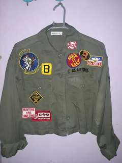 Green cropped jacket with patches