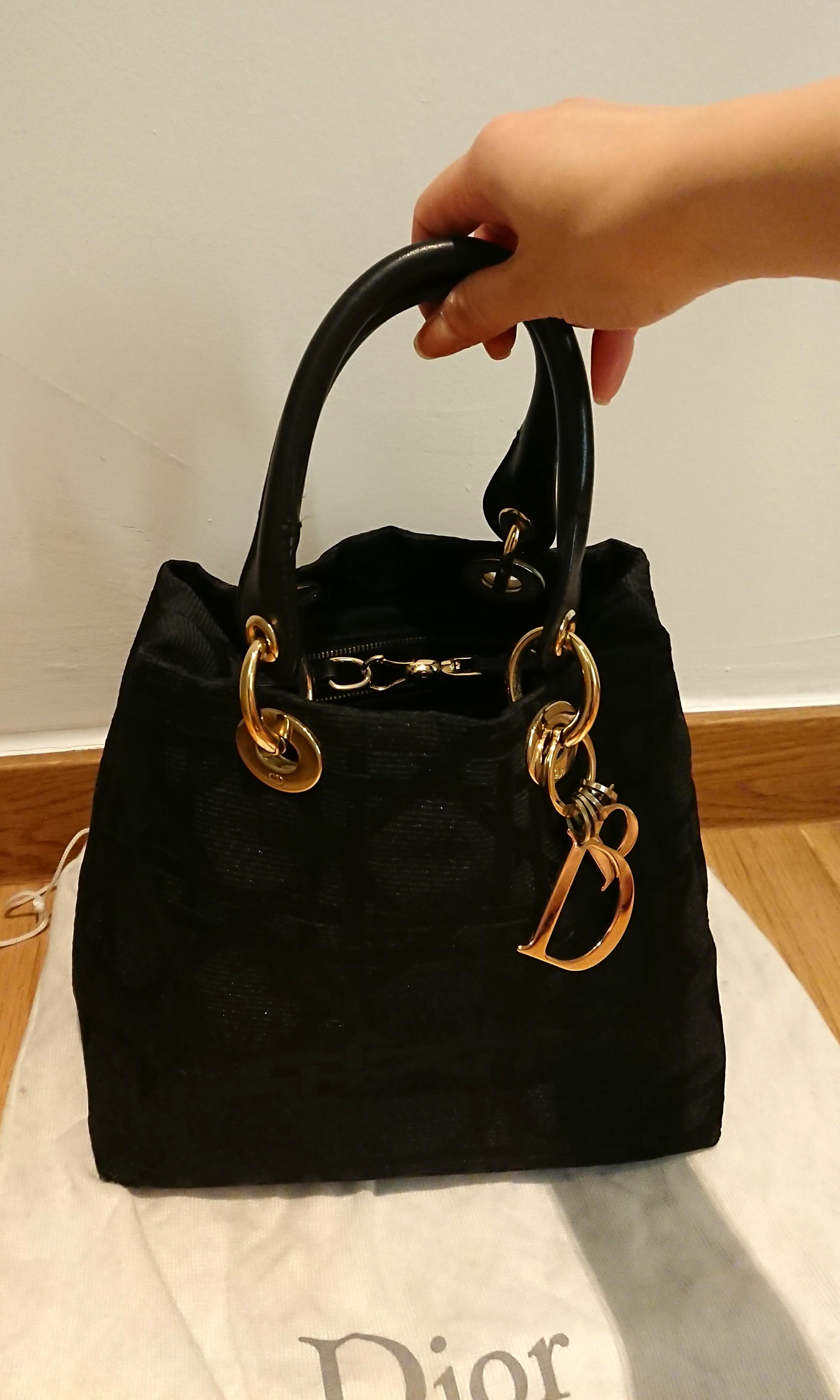 b12c9f0ff8fa Christian Dior Lady Dior handbag in Black canvas Cannage in Gold Hardware