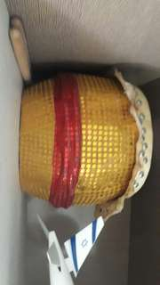 Golden and red decorated drum with real animal skin