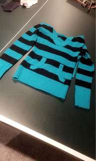 Blue and black striped top with a hood