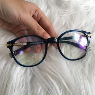 Blue specs with gold accent