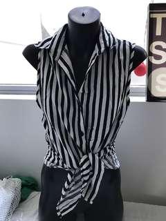 Blacks nd white monochrome stripped sleeveless collared shirt