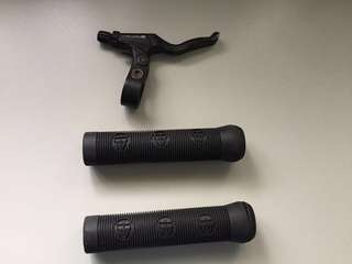 Two bmx grips with bar lock & a right hand lever