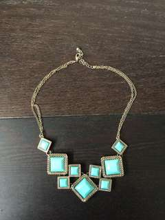 Turquoise and gold coloured costume necklace