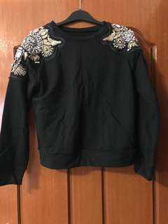 Jumper with embellished shoulders