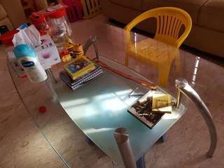Glass coffee table with below layer