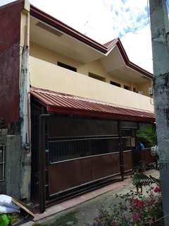 House and lot for sale at Fortunata Village Paranaque with 7 door apartments.