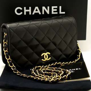Chanel Black quilted clutch purse with GHW