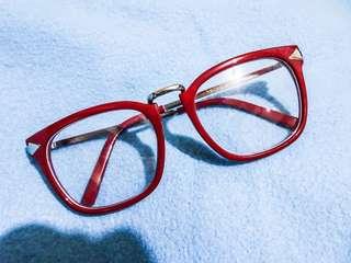 Red-framed Specs