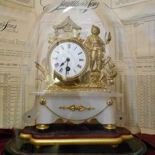 late 19th Century (1882) French antique gilt metal mantle clock on an alabaster base with a glass dome.