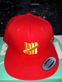 Undefeated snapback by yupoong