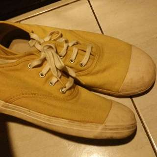 Yellow Muji flat sneakers