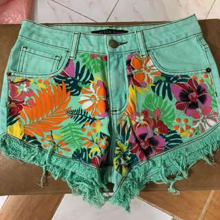 Green and floral shorts