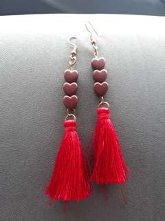 Red tassel earings with 3 hearts