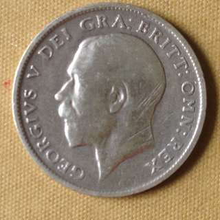 1916 GB six pence coin.