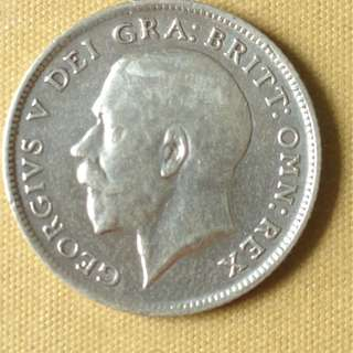 1914 GB six pence coin.