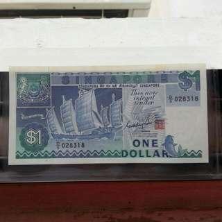 $1/unc/Singapore.