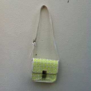 Lime green handbag. In good condition.