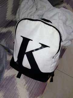 "Apostrophe backpack with a letter ""K"""