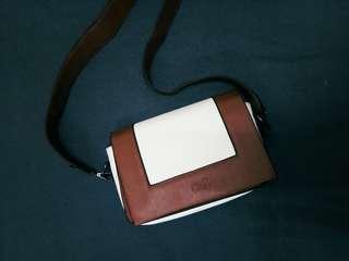 CR2 frame brown sling bag