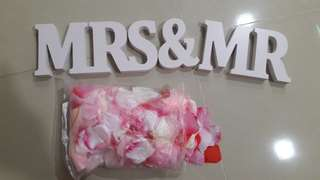 Mr & Mrs with flower petals