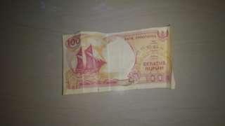 Uang kertas 100 rupiah perahu pinisi