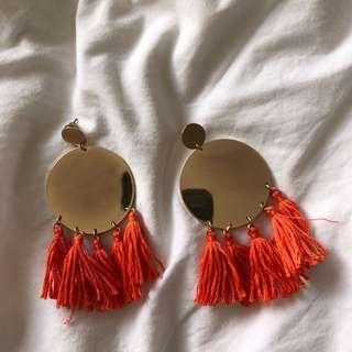Orange and gold tassel earrings