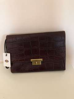 Fossil croc embossed clutch