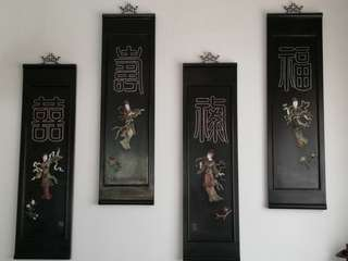 A set of 4 num wood panels with carvings of Chinese fairies.