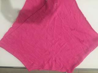 Pink knitted poncho